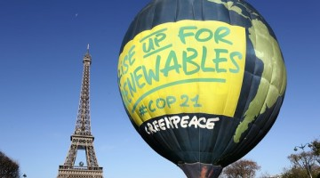 "The Greenpeace hot air balloon flies in Paris in front of the Eiffel Tower. The banners underneath the balloon read ""Rise up for renewables' in English and ""renouvelons l'énergie"" in French. This photo opportunity in Paris calls for climate action and energy from 100% renewable sources ahead of crunch climate talks in Paris."